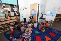 A recently graduated Northwest Florida State College Teacher Education student leads a class of preschoolers as part of her class requirement.