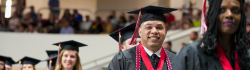 Smiling Student walks in the Spring Commencement Ceremony at NWFSC