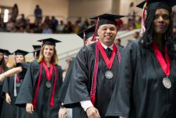 Student Walking in Commencement Ceremony Procession