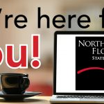 "Laptop with NWFSC Square Logo on Desk with caption ""We're here for you!"""