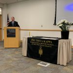 Dr. Stephenson addresses new members of Phi Theta Kappa at last year's ceremony.